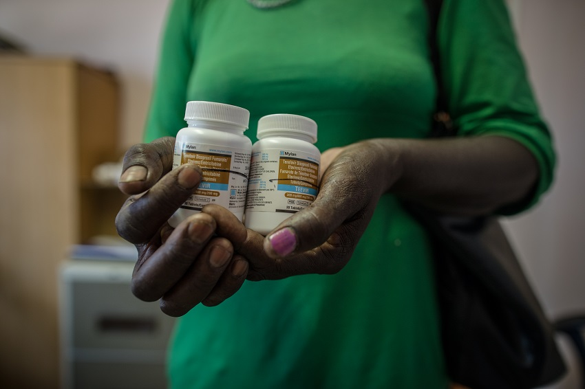 A patient holds antiretroviral medications at a health facility in Northern Namibia. Photo for IntraHealth International by Morgana Wingard.