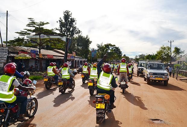 The drivers' motorcycles and year-round income—unusual in Kahama, where many livelihoods are based on seasonal farm work—make the boda boda drivers popular in the community. Many younger boys look up to them.