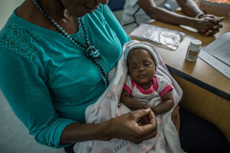 Shanamutango HIV clinic helps HIV-positive mothers like Katrina prevent transmitting the virus to their babies. Photo by Morgana Wingard for IntraHealth International.